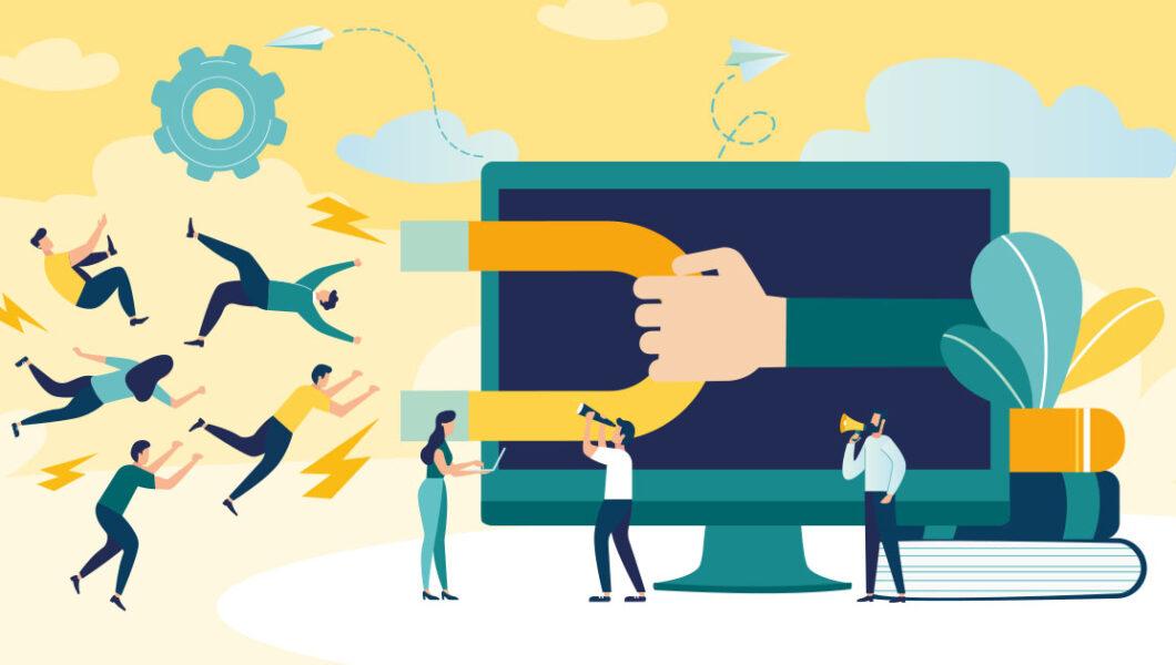 ilustracja, z granatowego ekranu komputera wystaje ręka z magnesem, która przyciąga ludzi